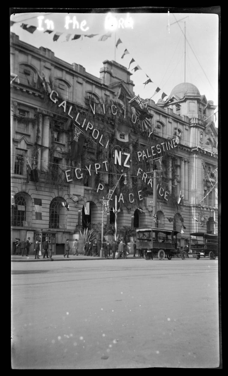 Auckland Central Post Office decorated for Peace Day Celebration, end of First World War - Auckland Libraries